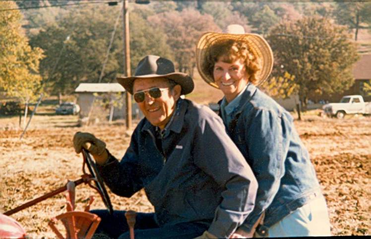 My father and mother sit astride his tractor on their land in Oroville, Calif. Circa early 90s.